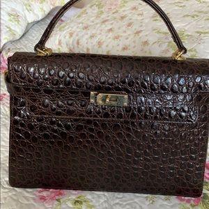Elegant brown leather rare hand bag.